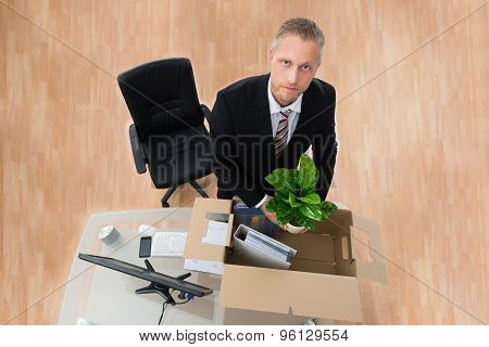 Businessman Packing Personal Things In Box
