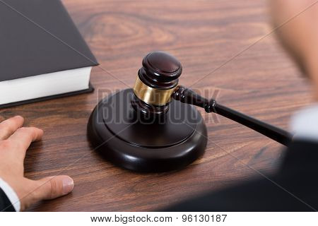 Judge Hitting Mallet At Desk