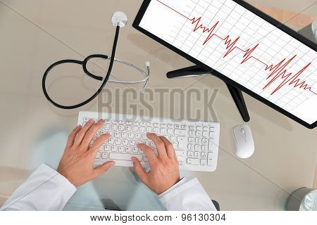Doctor With Computer Showing Cardiogram