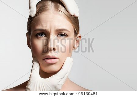 The girl in the stress with hands in gloves doctor