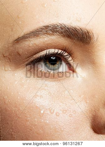 Close-up beautiful eye weth wet skin