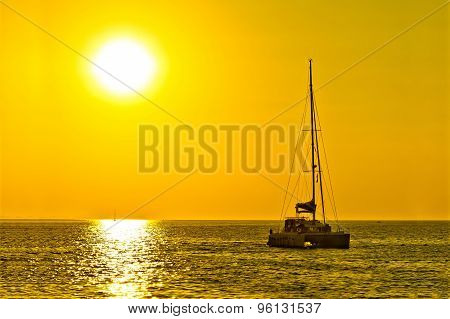 Catamaran Sailboat On Golden Sunset