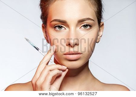 Portrait of a woman with syringe