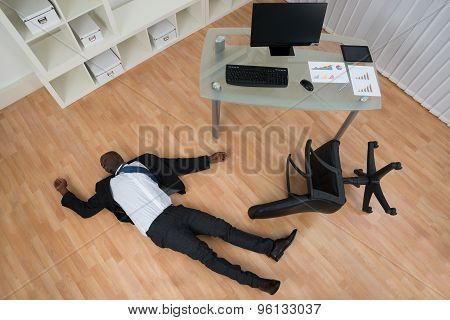 Unconscious Businessman Lying On Floor