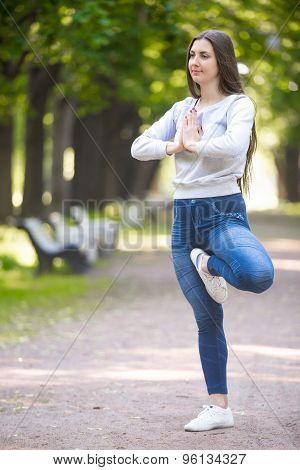 Portrait Of Yogi Woman Standing In Vrikshasana Pose