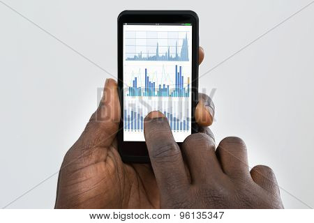 Person Using Cellphone Displaying Graph