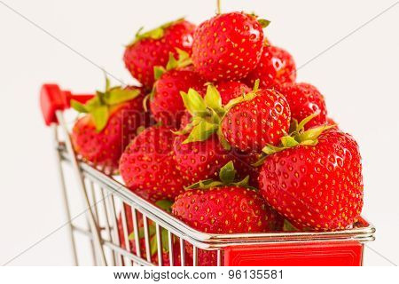 Minuature shopping cart with strawberries