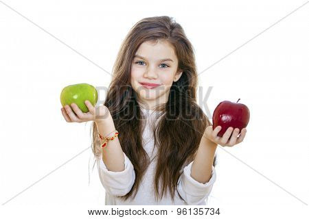 Little girl holding two apples, isolated on white background