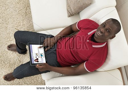 Man Surfing On Social Networking Website