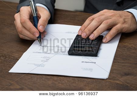 Businessperson Checking Invoice