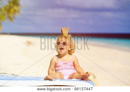 cute little baby princess on summer beach