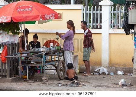 Local Family Buying Food On The Street Of Siem Reap, Cambodia