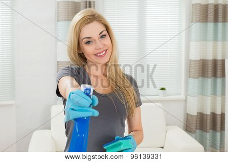 Woman With Sponge And Spray Bottle