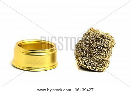 Metal Sponge Golden Color And A Stand