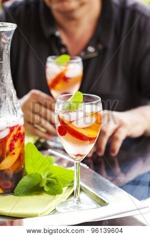 Man Drinking White Sangria.