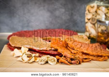 Various Types Of Dried Fruits On The Kitchen Table