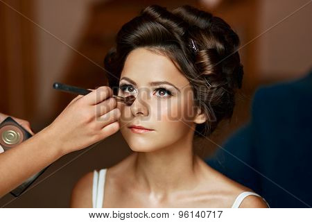 Beauty Portrait Of A Young And Attractive Woman Smiling And Applying Powder Make Up Cosmetics With A