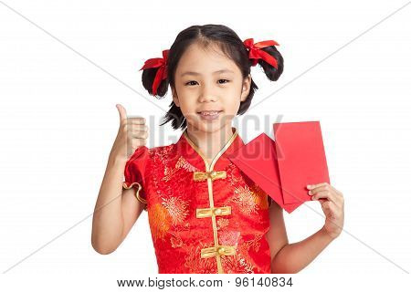 Asian Girl In Chinese Cheongsam Dress Thumbs Up  With Red Envelope