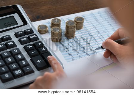 Person Analyzing Financial Report