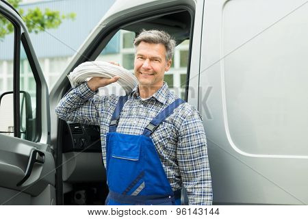 Repairman With White Cable
