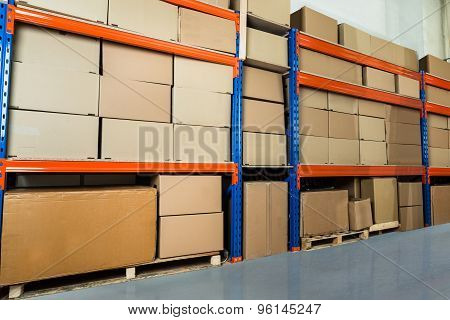 Warehouse Shelf With Cardboard Boxes