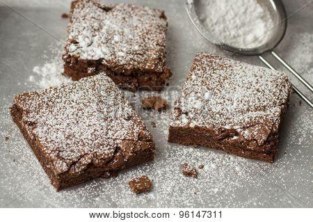 Brownie. Chocolate cakes with powdered sugar