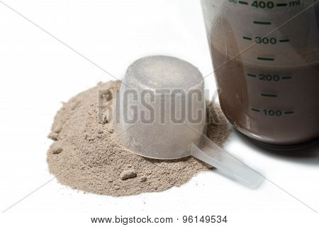 Chocolate Protein Shake With A Upturned Scoop Poured Protein Powder Isolated