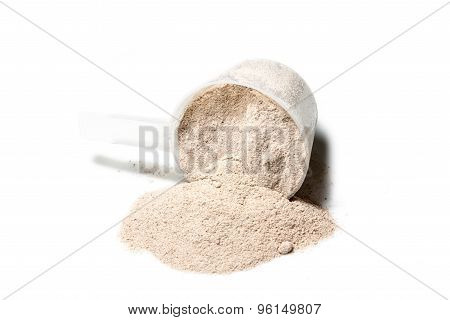 Scoop Of Isolate Protein Powder Chocolate Deluxe Flavour  Poured On White Background