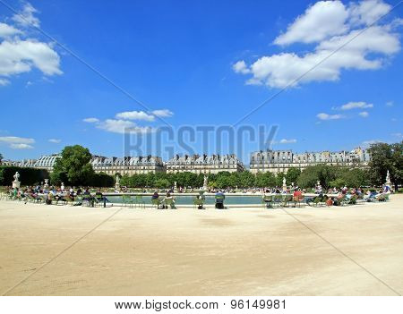 Sunbathing around a basin of Jardin des Tuileries (Paris France)