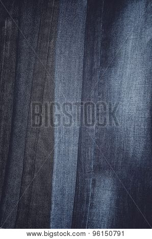 Jeans Hanging Vertically On A Hanger. Full Frame. Vertical