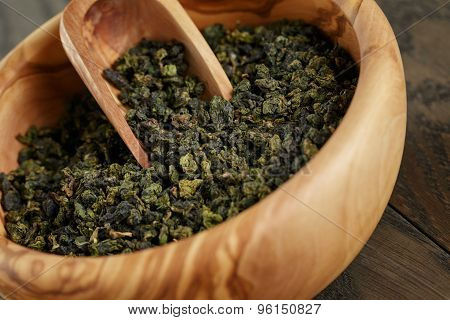 oolong green tea in wood bowl