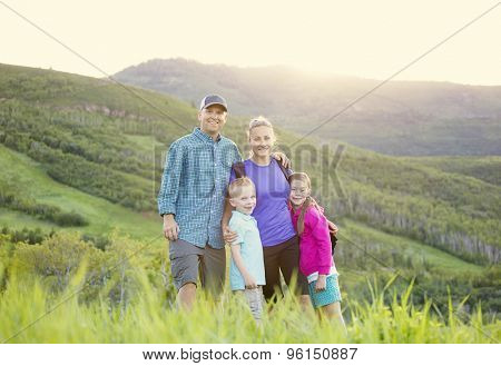 A beautiful young family hiking on a nice scenic evening in the rocky mountains of Utah in the United States of America