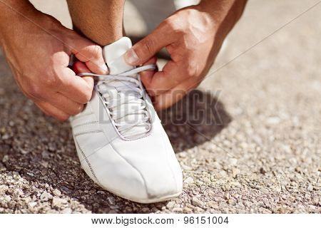 Man Tying His Shoes