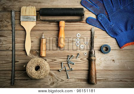 Work And Painting Tools On The Wooden Background Top View. Horizontal