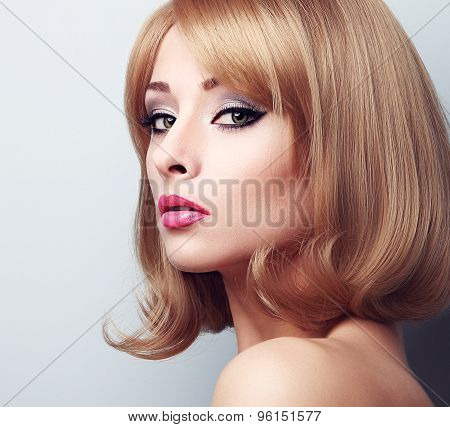 Beautiful Makeup Blond Woman With Bright Green Eyes. Closeup Portrait