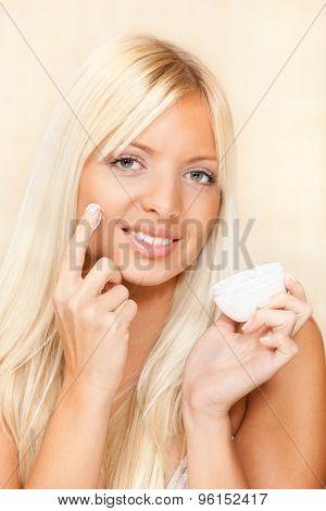 Beautiful Woman Applied Face Cream