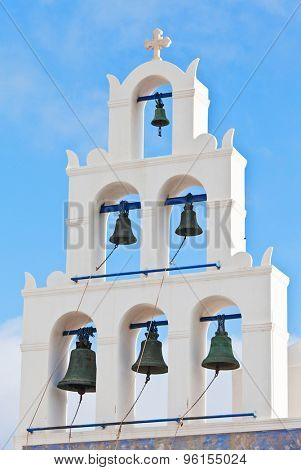 detail of church bell in oia santorini