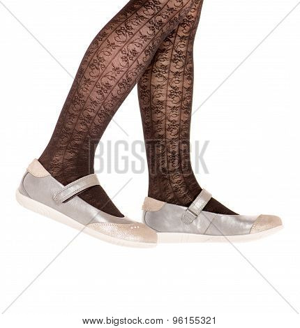 Girl's legs with tights and shoes isolated.