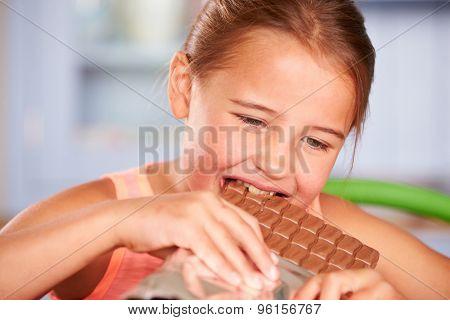Close Up Of Girl Eating Bar Of Chocolate