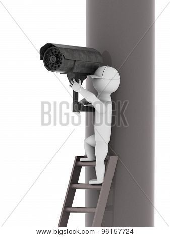 White Man Set Surveillance Camera On A Pole