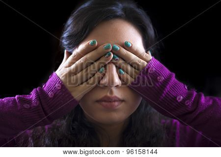 Woman Covering Her Eyes