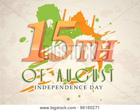 Glossy text 15th of August on famous monuments and flag color splash grungy background for Indian Independence Day celebration.