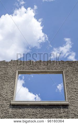 Old Wall Of Ruin Of House And Window Against Sky