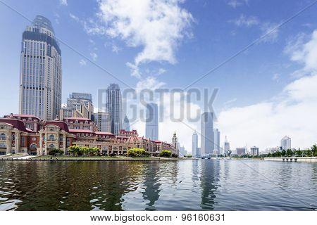 modern buildings in urban city at riverbank