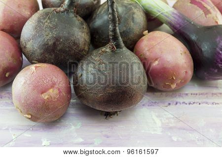 Whole Beetroots And Potatoes On The Wooden Table