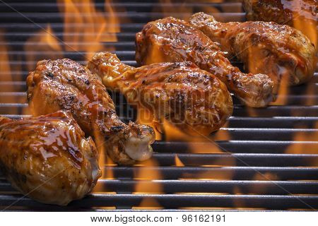 Chicken Grilling on a Flaming barbecue