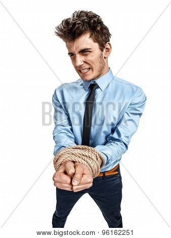 Businessman's Hands Tied Together With Rope, Modern Slavery Concept