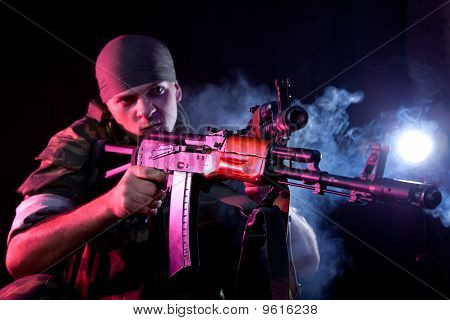 Aggressive Soldier In Uniform With Rifle