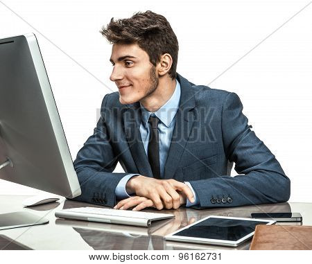 Employer Looking At Computer Screen With Pleasure