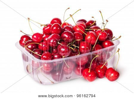 Sweet Cherries In Plastic Tray And Three Near Top View